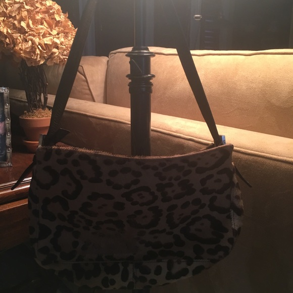 1b11e254ed Fendi Handbags - Rare leopard fur fendi baguette
